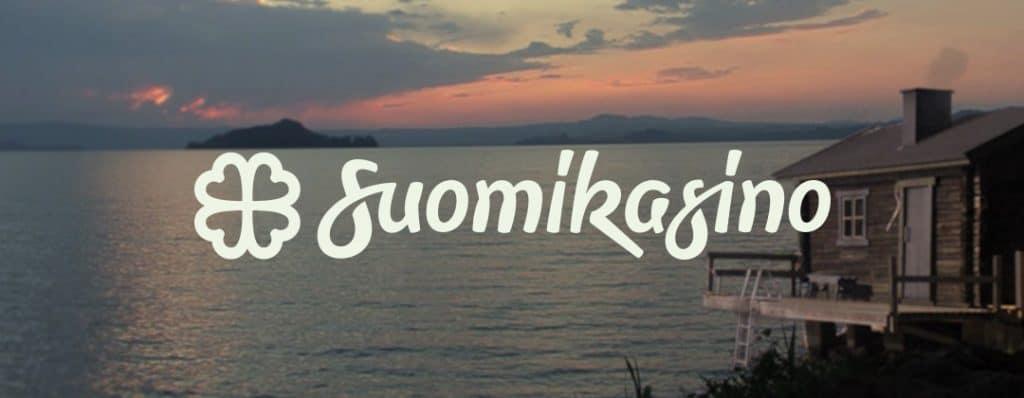 Suomi kasino logo ja suomalainen rantasauna järven rannalla